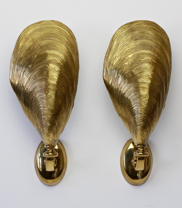 An absolutely stunning pair of midcentury wall-mounted sconces attributed to Maison Jansen, France, circa 1970s. In the shape of mussel shells and made of cast bronze, these are not dissimilar to lights made by Maison Charles - however, we believe