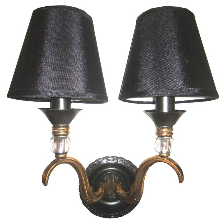 Pair of sconces by Maison Jansen in two patinas brass and gun metal. Custom larger back plate available. Max wattage: 40 with bulb Back plate: 4.5 inches. Wired for US and in working condition.