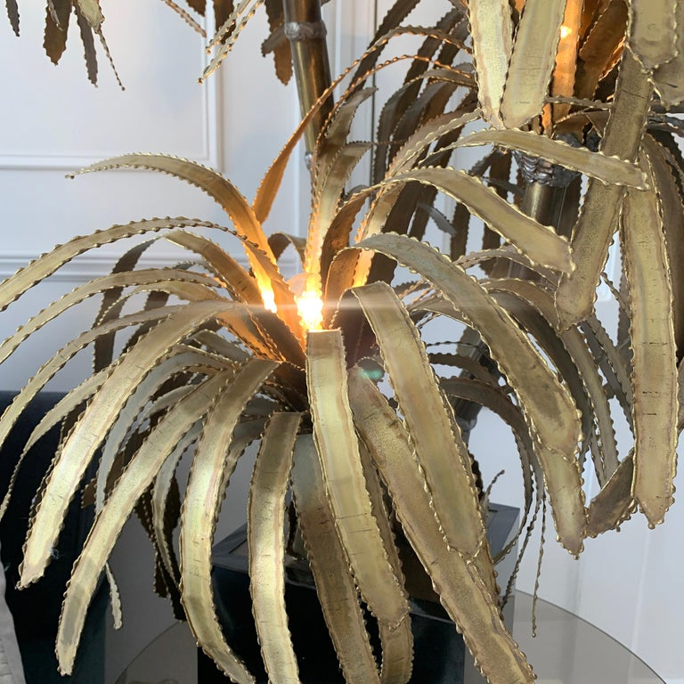 Maison Jansen brass Palm Tree lamp France, 1970s This is an original and unique piece, classic Maison Jansen design There are three main stems to the lamp with a single light fitting in each of the palm leaf tops The base pot is black in