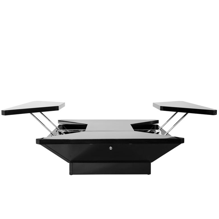 Maison Jansen coffee table constructed of black lacquered laminate and chrome-plated steel. The tabletop consists of four 'petals' or panels that spring up when pushing buttons on a mechanized system while the middle square panel remains stationary.