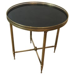 Maison Jansen, Round Neoclassical Style Brass Side Table with Black Top, French