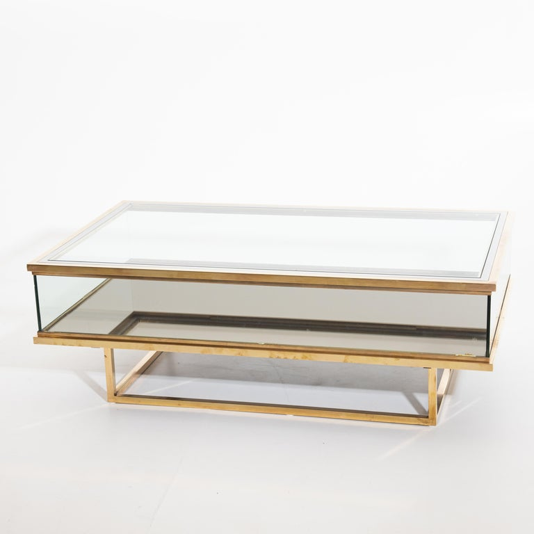 Large rectangular coffee table by Maison Jansen in the 1970s. Made of brass and glass with a sliding top.