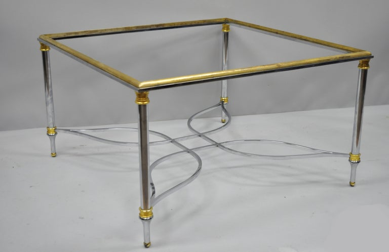 Maison Jansen style chrome steel and brass square coffee table base. Item features star form stretcher, brass rim and accents, tapered legs, and great style and form, circa 1960. Measurements: 17