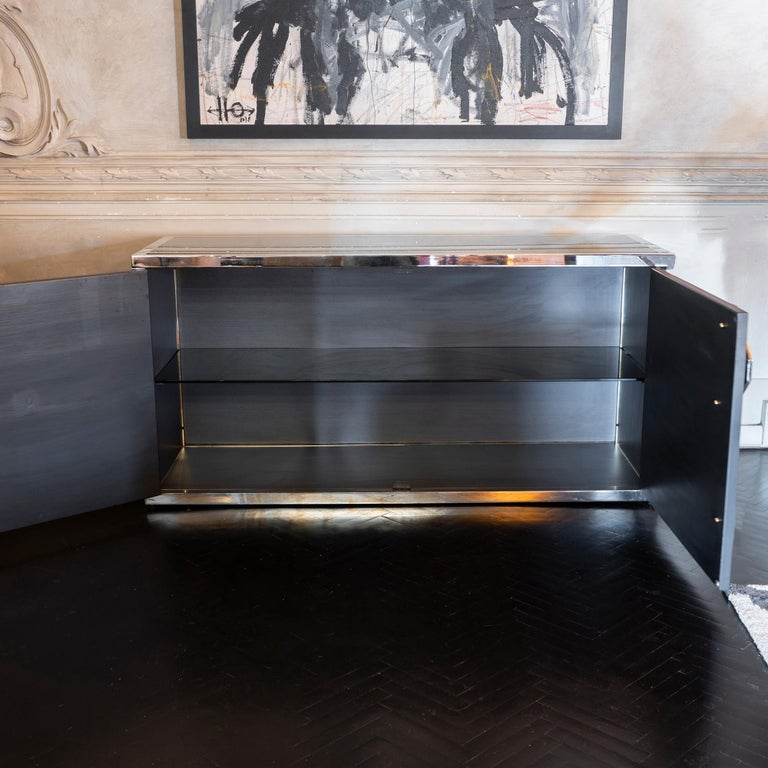 Sideboard in original and patinated chromed brass and black steel faux bamboo, top is in black tempered glass along with the interior shelf, geometric chrome metal door handles, France 1970s.