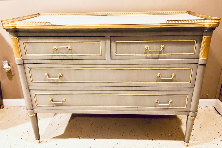 Maison Jansen style painted commodes, chests or nightstands a pair of stunning Louis XVI style fine bronze mounted chests each having a pierced bronze galleried marble top supported by two over two drawers all having a bronze frame and pulls. The