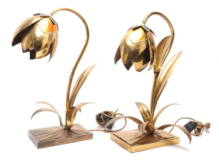 Pair of Maison Jansen style Mid-Century Modern brass and enamel table lamps, in flower form with curving stem, leaves, and rectangular bases. Size: Approximate 18.5