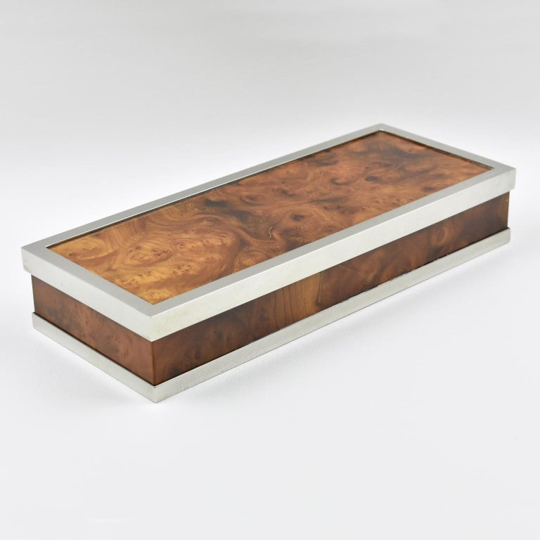 Stylish Maison Lancel Paris decorative lidded box. Extra-long rectangular shape with a sleek design. Framing in polished chromed metal compliment with high gloss varnish burl wood. Engraved on the top of lid 'Lancel'. Interior in sycamore