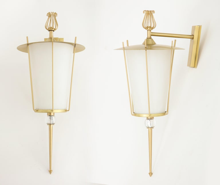 Pair of French midcentury lantern style brushed brass sconces with satin finished opaline white glass diffusers. Sconces have been rewired for use in the USA.