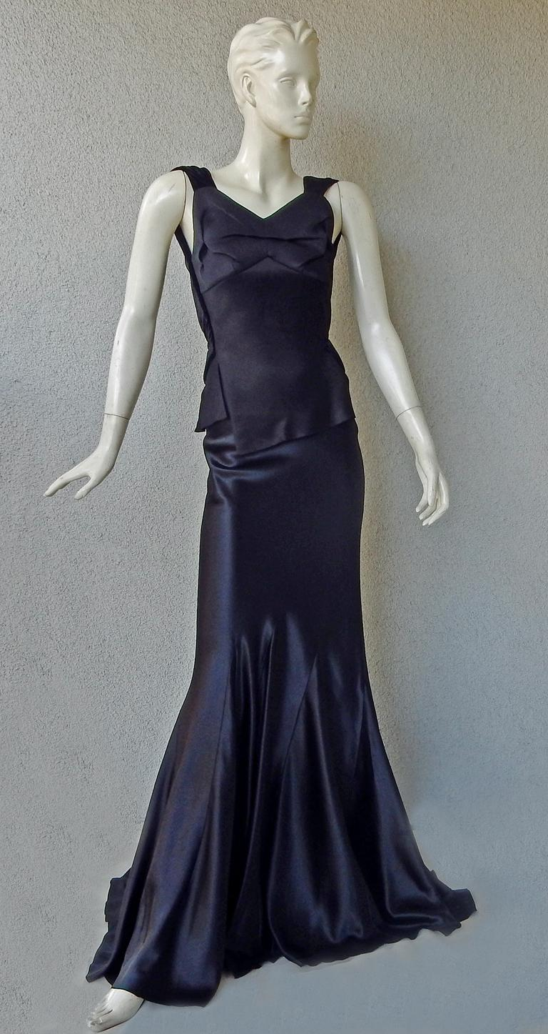 Maison Margiela by John Galliano enchanting bias cut gown.  Features black velvet shoulder straps with narrow asymmetric peplum at waist extending into black silk charmeuse bias godet skirt.  Dramatic exposed back. Sophisticated construction. Side