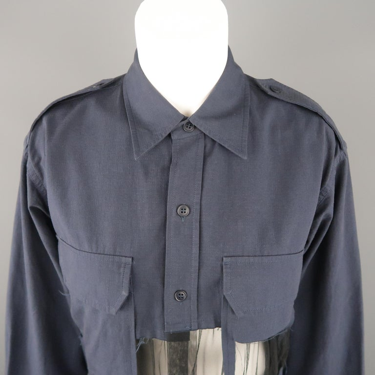 MAISON MARGIELA oversized military style shirt comes in muted navy blue textured canvas with a pointed collar, epaulets, patch flap breast pockets, and gathered black tulle deconstructed insert panels. Made in Italy.   Excellent Pre-Owned