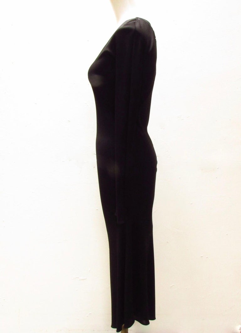 Black viscose dress from vintage Maison Martin Margiela accentuates all the right curves with it's bias cut