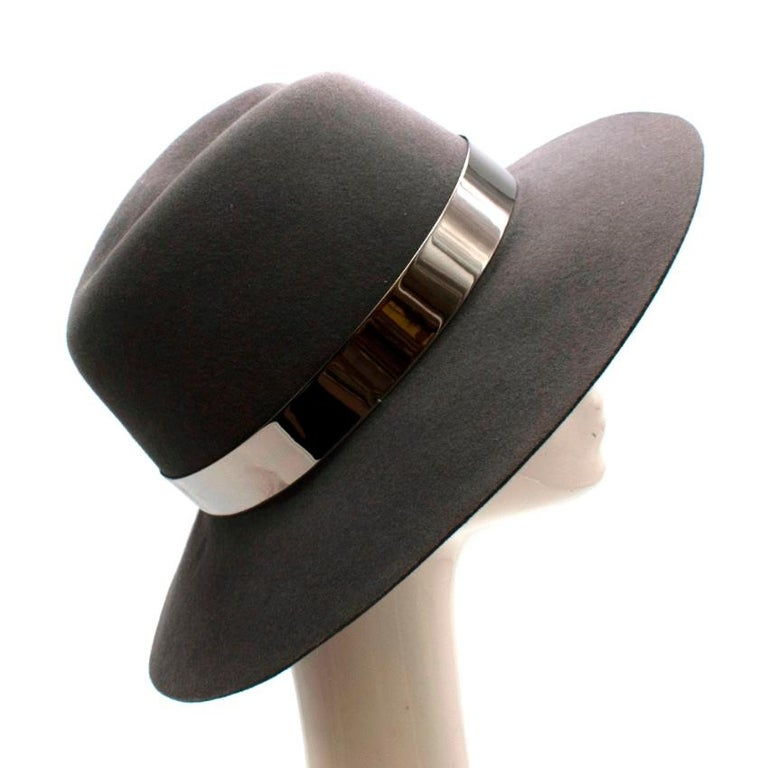 Maison Michel Grey Felt Fedora Hat with Metal Band  -Luxurious velvet like texture  -Beautiful neutral hue  -Classic style with a twist  -Metal band  -Stunning slash detail to the front   Materials: 100% rabbit felt  Made in France   Circumference-