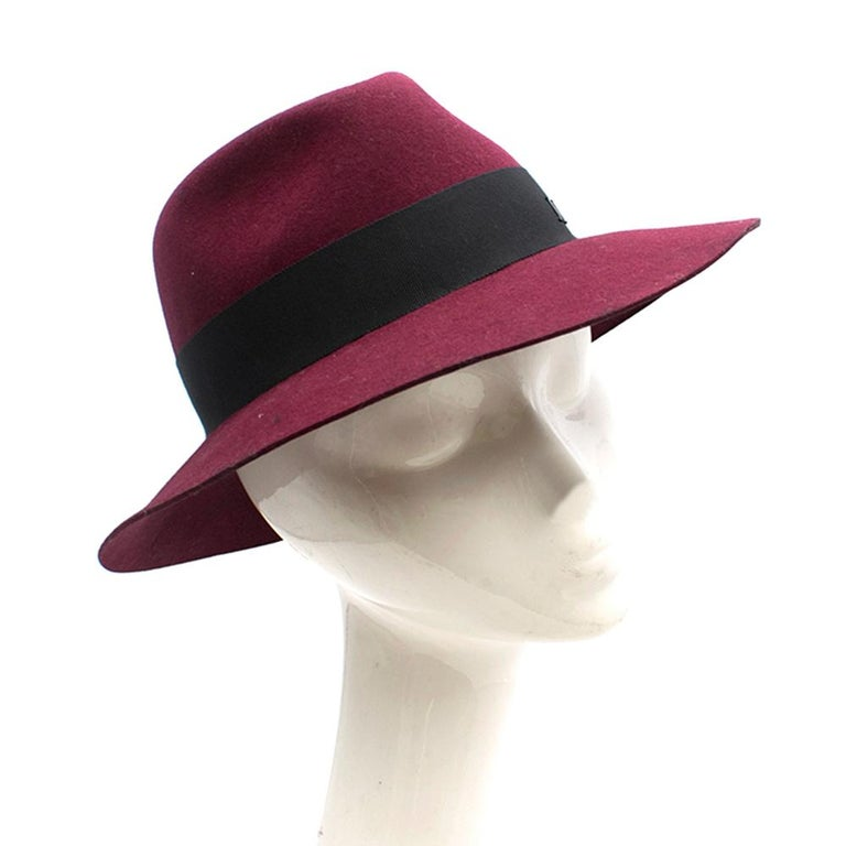 Maison Michel Burgundy Red Fedora  -Virginie model -In red burgundy wool felt -Grosgrain ribbon with 'M' logo -With a box   Please note, these items are pre-owned and may show signs of being stored even when unworn and unused. This is reflected