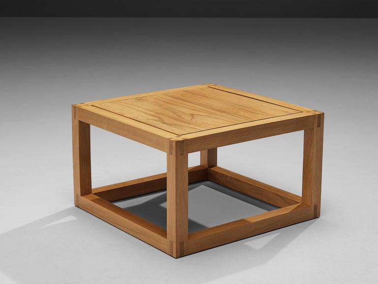 Maison Regain, coffee table, solid elm, France, 1970s  Cubic coffee table with admirable wood joints by French manufacturer Maison Regain. A square builds the main theme and repetitive form of this side table. The squared top rests in a frame of