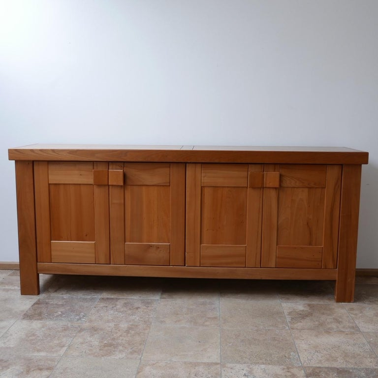 A scarce large credenza by French design company Maison Regain,  Formed from Elm, circa 1970s.  Maison Regain were the main competitive force to Pierre Chapo and designed many similar pieces in the circa 1970s in France.  Good quality
