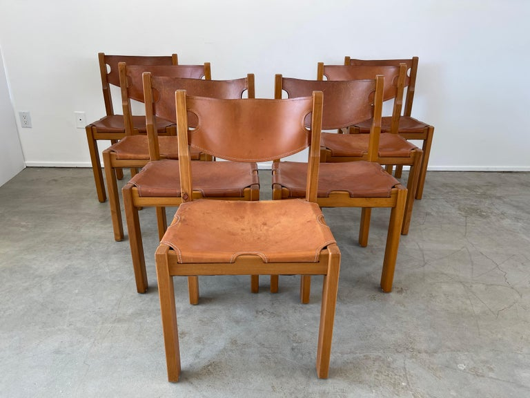 Maison Regain leather and elm wood chairs Great patina to leather and construction  Priced individually.