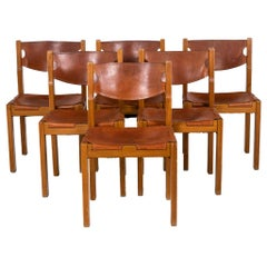 Maison Regain, Series of Six Chairs in Elm and Leather, 1960's