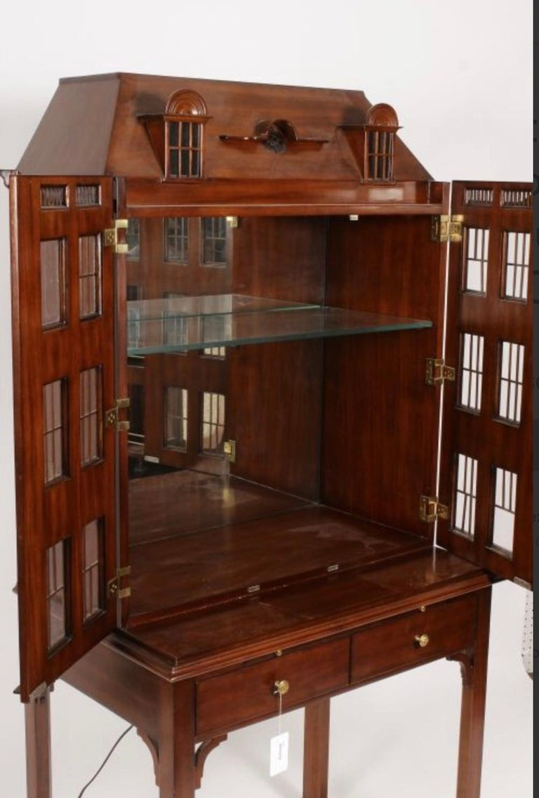 Maitland Smith Iconic Postmodern Victorian Dollhouse Bar Cabinet Cupboard. Incredible detail with glass windows, copper mullions and hand carved architectural details. Heavy glass interior shelf. Embossed leather slide.