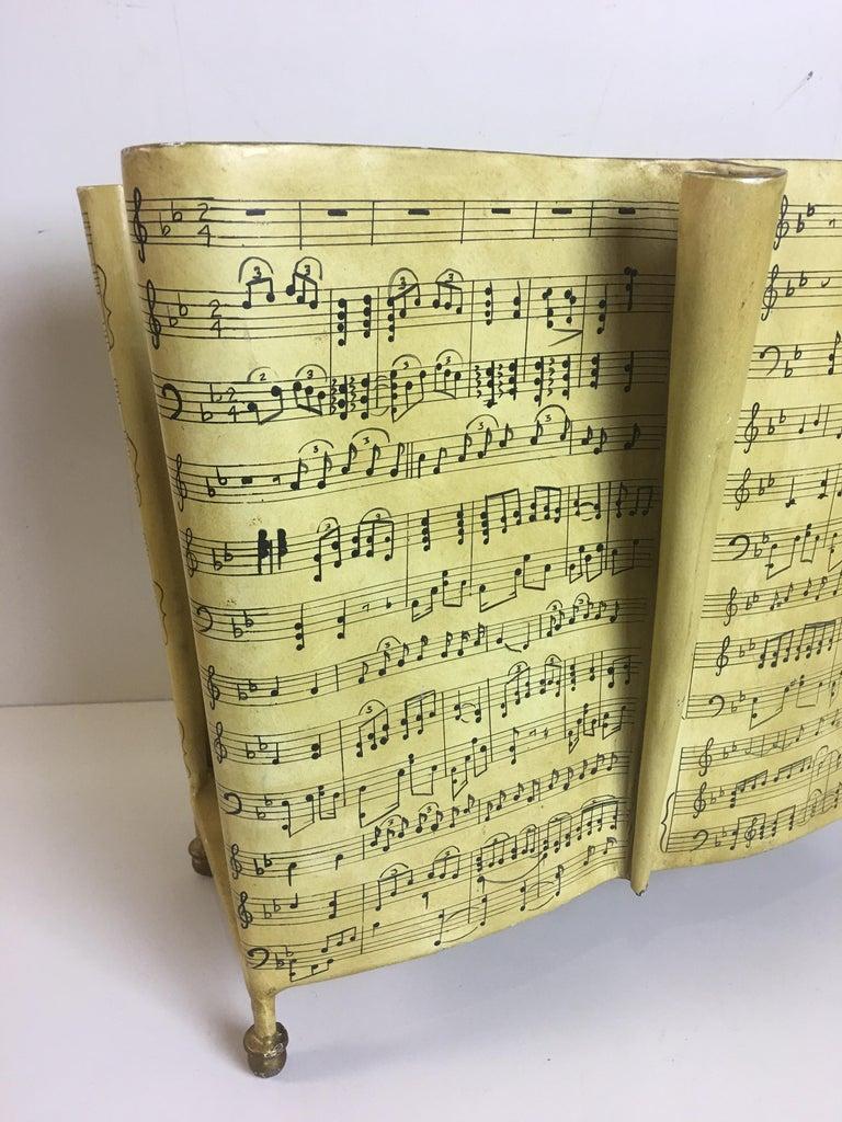 Maitland Smith Sheet Music magazine Holder. Pale yellow/ ivory paint with black music notes. Whimsical design!