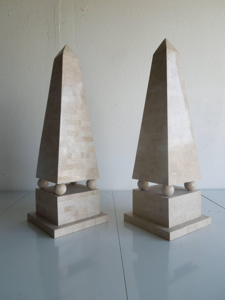 From a very upscale Palm Springs estate, a rare pair of large tessellated stone obelisks done in the