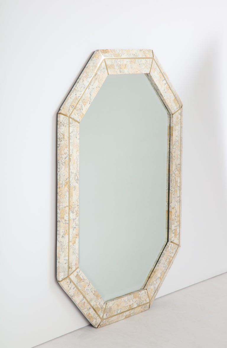 Maitland Smith octagonal tessellated stone and inlaid brass mirror  Philippines, circa 1980. Size: 40 1/2
