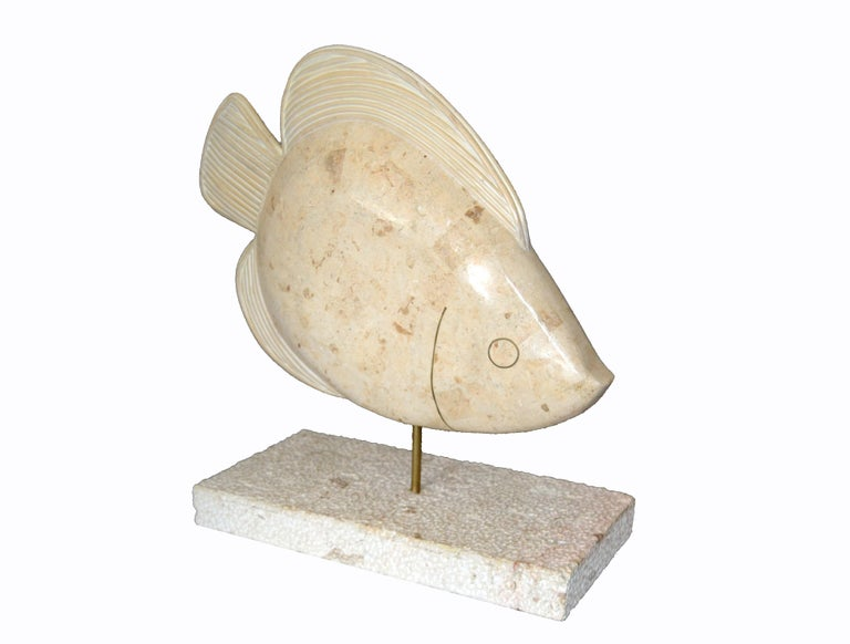 This is a Maitland-Smith tessellated horn and coral fish sculpture with brass details. The fish is mounted on a coral base with a brass rod. It is marked underneath, Made in Philippines.