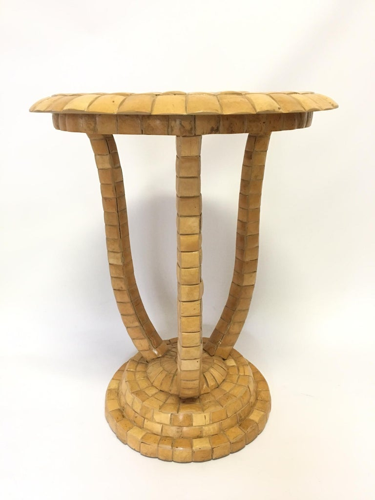 Tall Maitland Smith side table believed to be cast resin. Table is covered in a mosaic of small tiles that appear to be a shell-type material. Very heavy and well-constructed. Good vintage condition with some spacing appearing between tiles, yet all