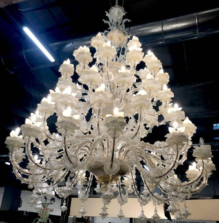 Amazing Murano chandelier: 64 arms!!! Five floors of lights and a multitude of flowers in glass paste and gold inclusion. An authentic masterpiece out of the historic Murano furnaces.