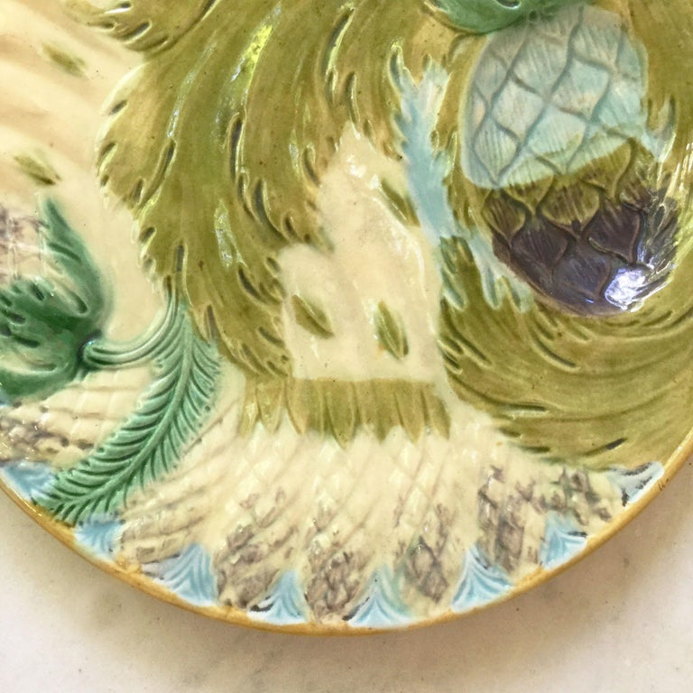 Unusual majolica asparagus plate attributed to Saint Amand, circa 1880. 6 plates are available.