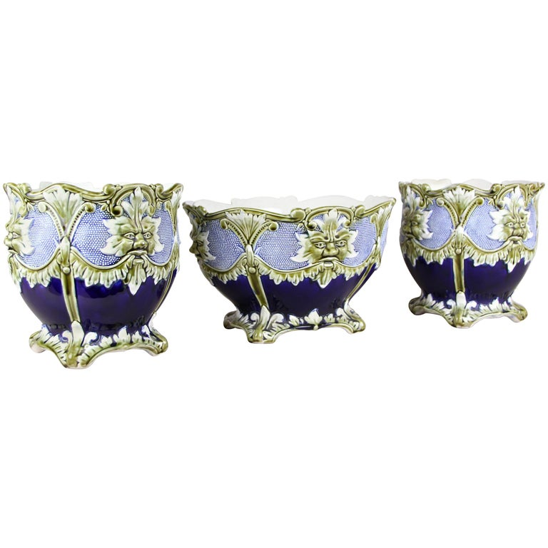 Beautiful Majolica cachepot set of three by J. Bernard De Bruyne. Made in the beginning of the 20th century by the well-known French manufactory, this very decorative cachepot set consists of two similar cachepots and a