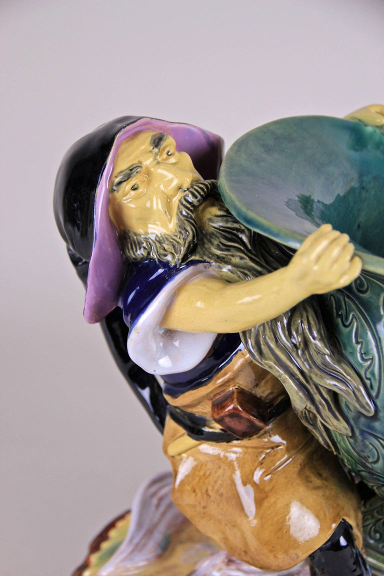 We proudly present this big super rare Majolica centrepiece by Wilhelm Schiller & Son out of Bohemia, circa 1880. This gorgeous Majolica centrepiece showing a dwarf holding a big bowl in a unique and outstanding design. This figurine centrepiece