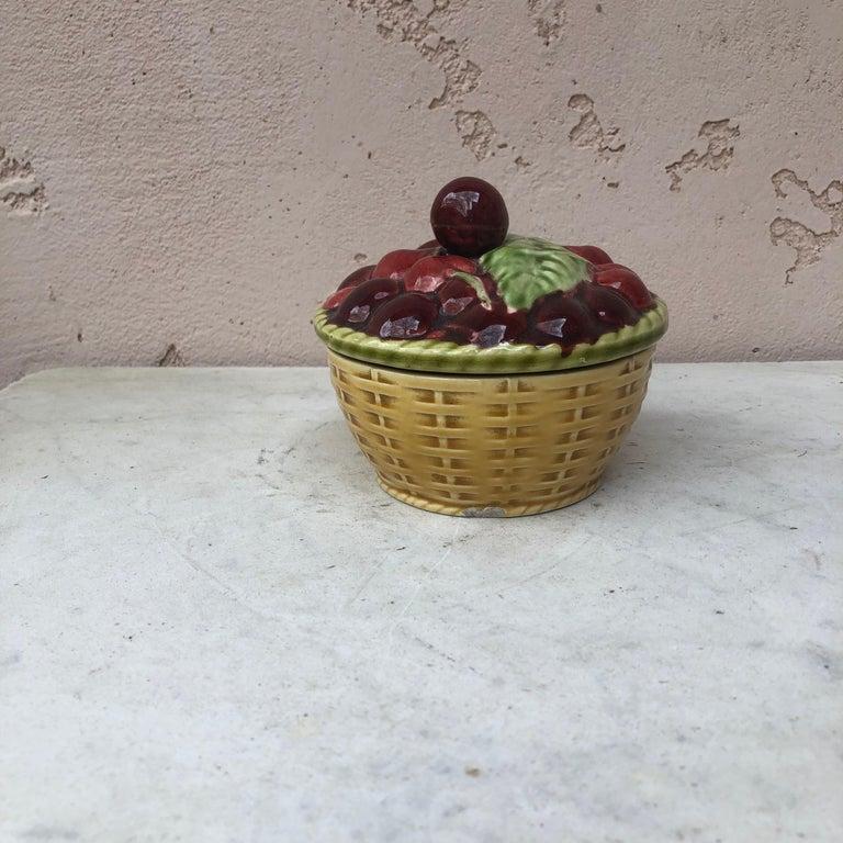 Majolica Trompe l'oeil basket with cherries handle signed Sarreguemines, circa 1920.