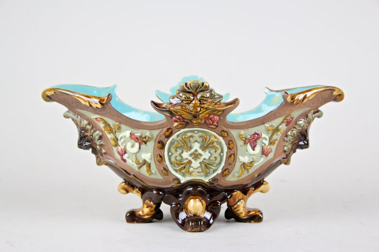 Wonderful made Majolica jardinière by the famous company of Wilhelm Schiller & Son circa 1890. Coming with a lovely hand-painted floral design, the unusual shape is very typical for pieces out of the renown ceramic/ majolica manufactory of W.