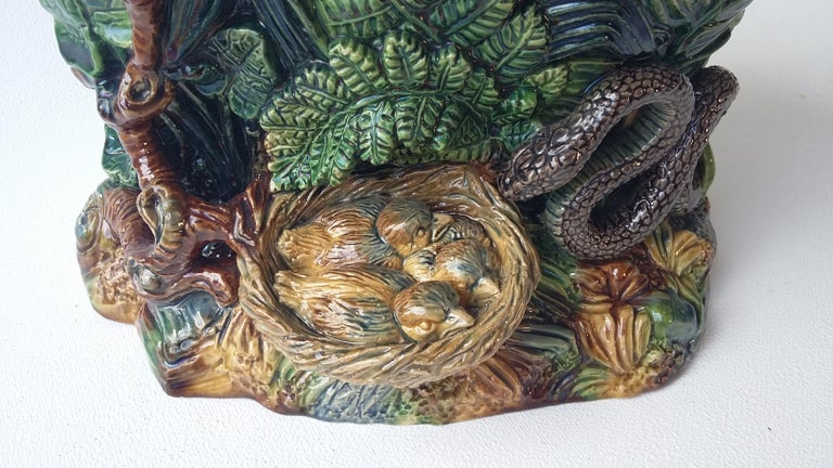 A naturalist Majolica jardinière with different kind of leaves, large ferns leaves, a branch on the front and a nest with birds threatened by a snake signed Johann Maresch (1821-1914 Austria).
