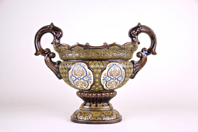 This beautiful Majolica Jardinière by Gerbing & Stephan comes with an amazing worked design and was produced by in the famous ceramic/ majolica manufacturer circa 1890. Beautiful warm earth tones and hand painted applications on both sides are