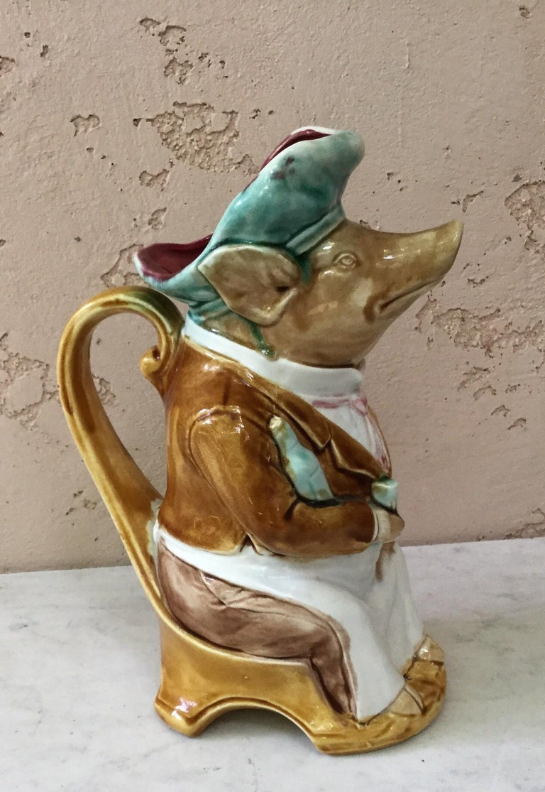 French Majolica pig dressed as a waiter signed Onnaing, circa 1900.