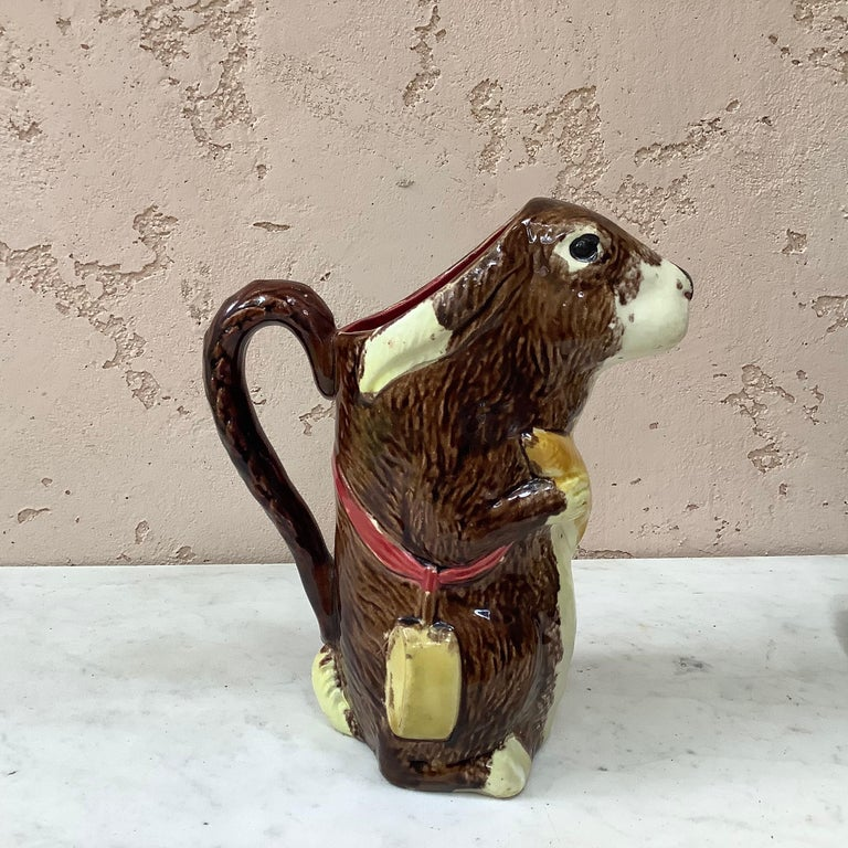 A rustic Majolica brown rabbit with carrot pitcher signed from the manufacture of Orchies circa 1890 model number LP2. This pitcher exist in different colors of carrot. Reference / Page 111