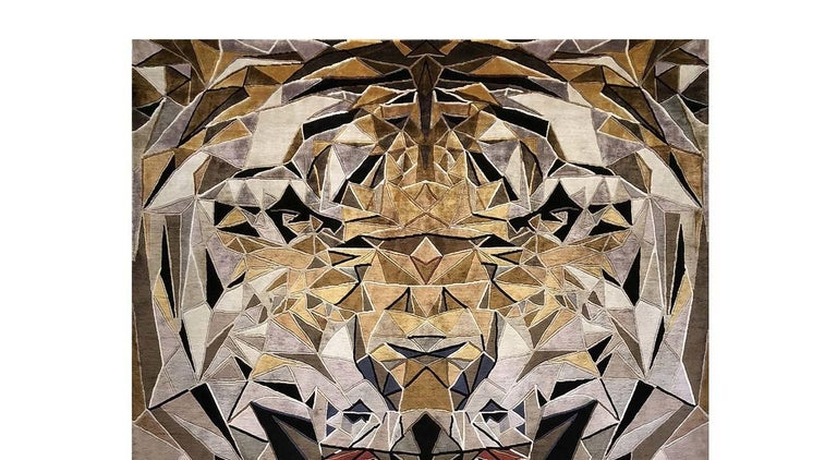 A spectacular rendition of the head of a tiger, depicted while roaring at the viewer and rendered using geometric elements, is the stunning decoration of this rug is part of the exclusive Limited Edition Collection. This bold piece is hand knotted