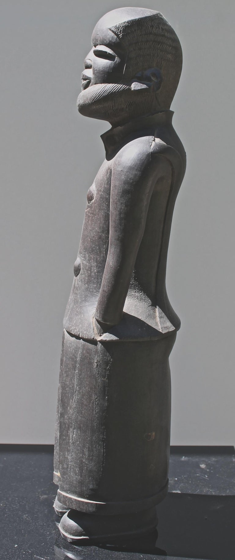 A beautiful modern piece of sculpture of a distinguished gentleman. Executed by a Makonde master carver in ebony. Well dressed, complete with cuffs, creases and shoes.