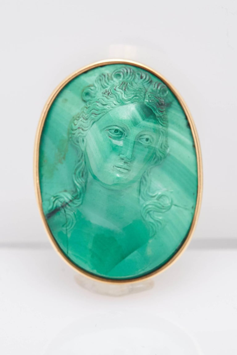A pair of retro malachite cameo ear-clips, mounted on 18kt yellow gold. Made in Italy, circa 1950.