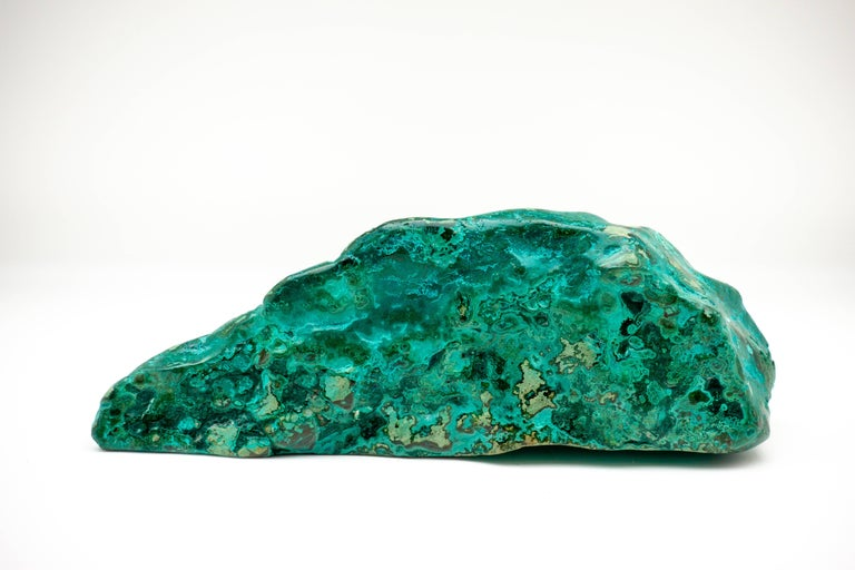 Richly marbled chrysocolla-malachite specimen with a vibrant emerald color. The beautiful blue-green of chrysocolla has made it a prized gemstone in ornamental use since antiquity.