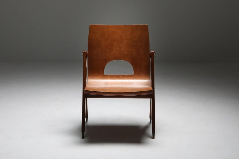 Ico Parisi for Malatesta and Mason, Italy 1950s.    Bubinga, mahogany and brass  Gorgeous examples of mid-century modern Italian design.  These sculptural armchairs were produced by Malatesta and Mason in Rome in the early 1950s. The elegant,