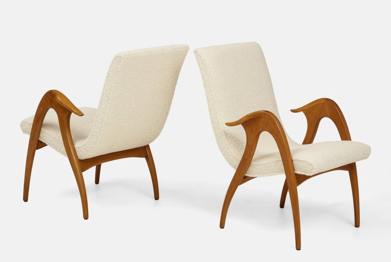 Malatesta and Mason pair of sculptural armchairs consisting of upholstered high backs and seats and curved figural wood arms and legs. These organically sinuous armchairs exemplify the craftsmanship and originality of Mid-Century Modern Italian