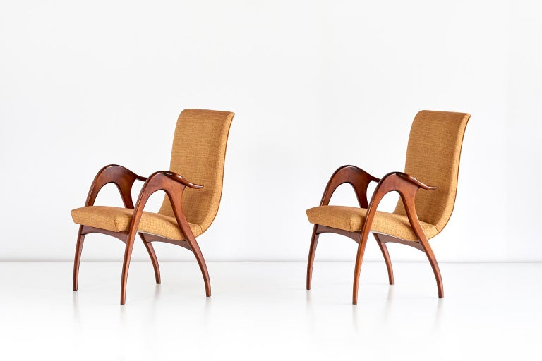 These sculptural armchairs were produced by Malatesta and Mason in Rome in the early 1950s. The elegant, organically shaped frames are complemented by the dynamically flowing line of the seat. The legs and armrests are characterized by the warm