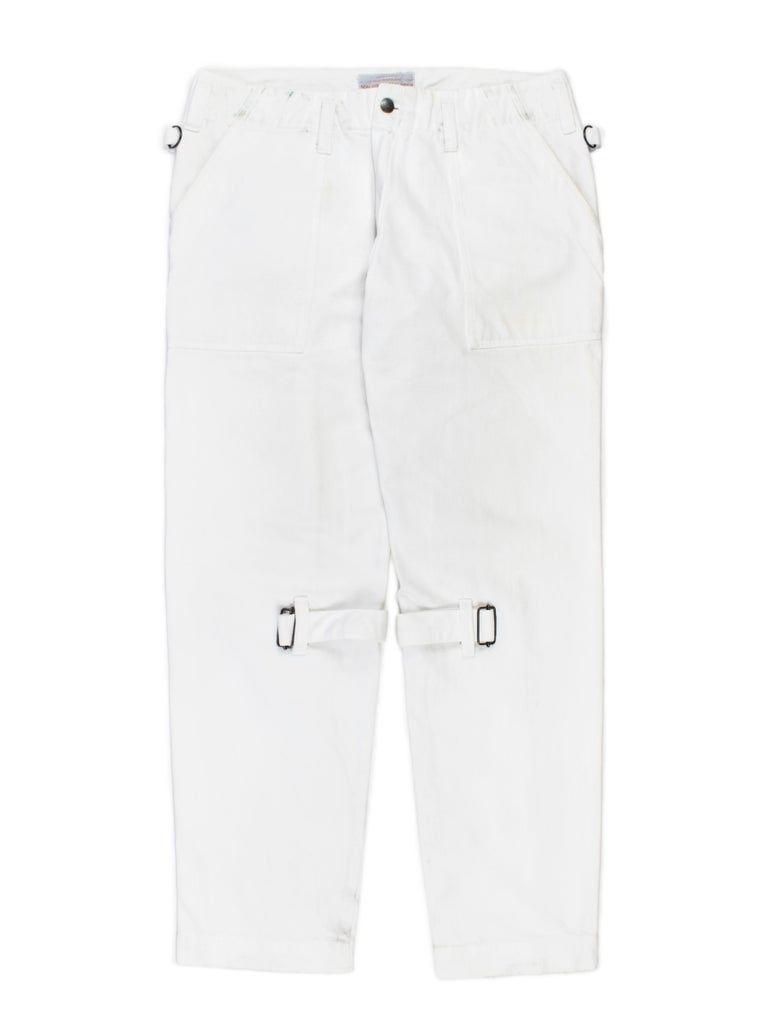 These trousers come from a limited line released under the iconoclastic McLaren's own name in the '90s. They have the label's thumbprint tag on the back pocket, and feature the same detailing as the pants he put out under Seditionaries with Vivienne
