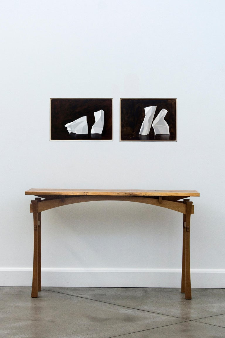 Malcolm Rains explores harmony and austerity in this poised still life painting of bent white paper on a dark burnt umber ground. Through the pronounced use of light and shadow and trompe l'oeil realism, Rains' work seeks a mystical or conceptual