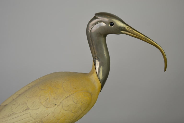 Ibis bird sculpture by Malevolti Italy.  This bird statue is made of resin with silvered metal head and legs.  Italian Design Sculpture circa 1950s.