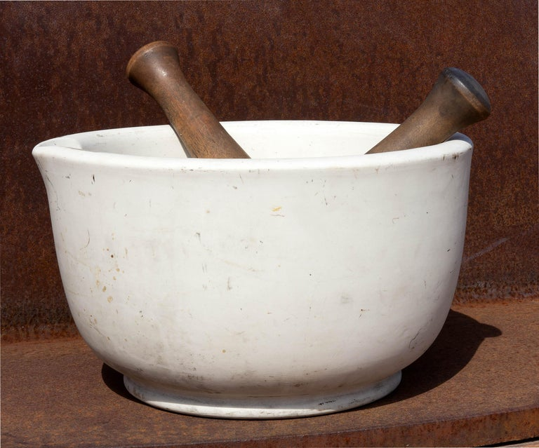 Mammoth porcelain mortar and pestle. Great for cooks or as an accent piece. . Heavy duty. Mortar weighs over 25 lbs. 14.75
