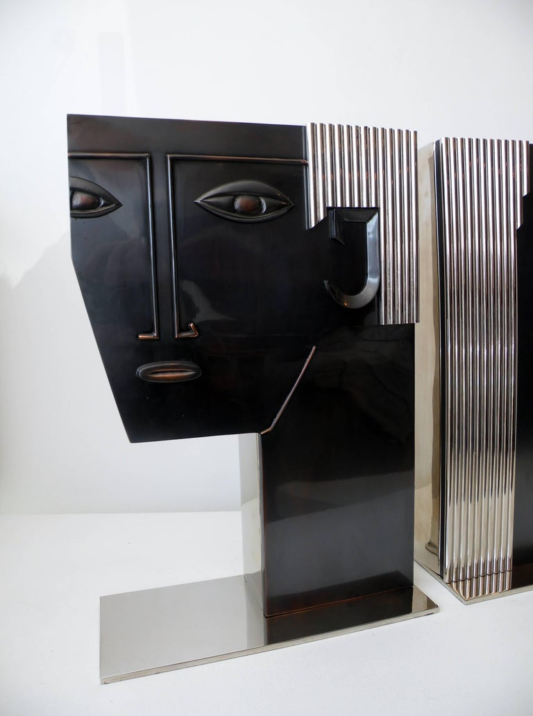 Large-scale pair of Art Deco face vases of a man and woman inspired by similar pieces by Franz Hagenauer. Fine quality manufacture, all metal construction, heavy in the hand, unmarked and date to the 1980s.