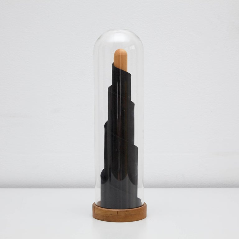 Le Tour sculpture created by Man Ray in 1981.  Signed by the artist, numbered and titled underneath the base. From the edition of 99.  Measure: 12.7 x 39 cm.  (Man Ray 1890–1976) was an American visual artist who spent most of his career in